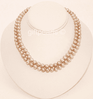 Double-stranded lavender pearls with polished sea-shell clasp.